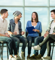 a group of young people laughing on their meeting