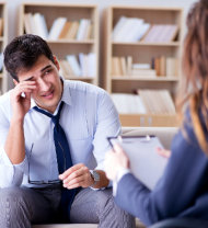 counselor listening to a teary eyed man's problem