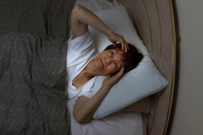 elder woman awaken from sleep